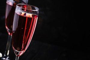 Red sparkling wine, black background