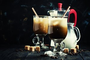 Ice coffee in glasses on a dark back