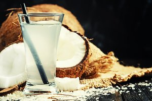 Coconut water, dark background, sele