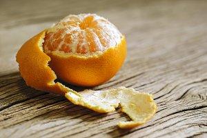 Mandarin orange on wood background