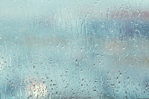 Raindrops on a window in evening