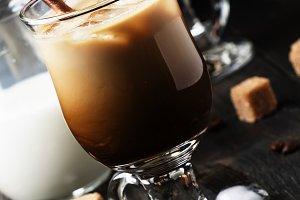 Iced coffee in glass, milk, sugar an