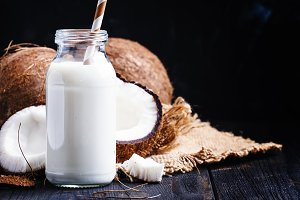 Coconut milk in a glass bottle, dark