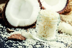 Coconut shaving in a glass jar, dark