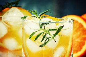 Refreshing drink with orange, rosema