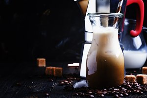 Cold iced coffee with milk and ice i
