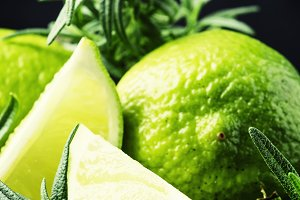 Lime and rosemary, black background,