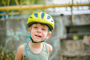 Boy wearing helmet, smiles in the