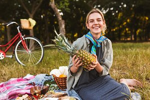 Joyful girl sitting on picnic