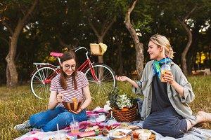 Beautiful girl sitting on picnic