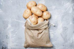 Fresh potatoes in a canvas bag, food