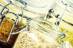 Assorted cereals in glass jars: kino