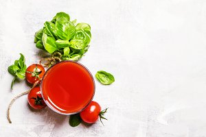 Tomato juice with green basil and sp