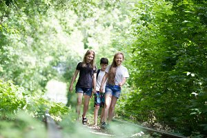 Children walking in the woods on an