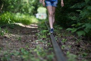 Legs of teenagers walking on