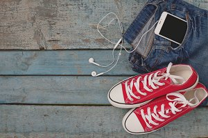 Red retro sneakers and smartphone wi
