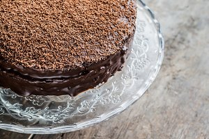 big chocolate cake on festive glass