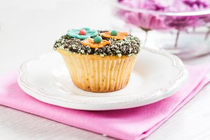 cupcake with chocolate ganache and d