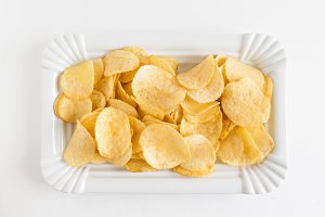 potato chips in a white dish isolate