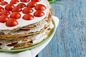 zucchini cake with tomato and parsle