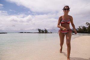 Woman running on beach deer island i