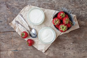 Yogurt with strawberries in a glass