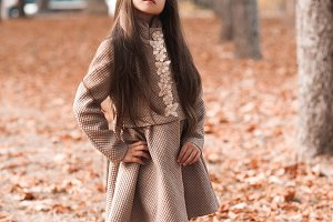 Pretty girl in autumn park