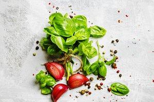 Food background, green basil, garlic
