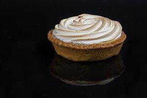 Lemon cake with meringue tartlet on