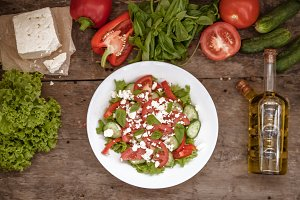 Shopska salad in a white plate on a