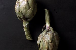 Fresh artichokes on dark background