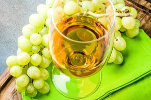 White wine glass with grapes