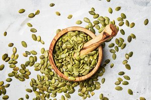 Raw pumpkin seeds, food background,
