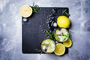 Summer cocktail with lemon, rosemary