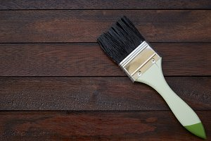 Paintbrush on a wooden background