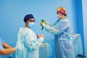 Surgeon dresses before surgery
