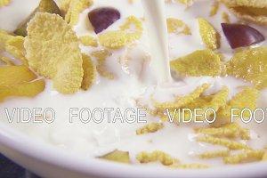 Slow motion in corn flakes pour milk