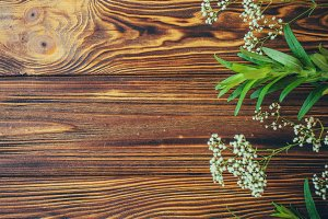 Greenery and baby breath on wood