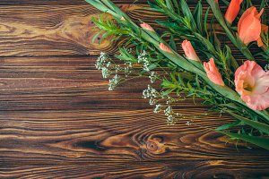 Gladiolus flowers bouquet on wood