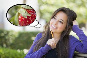 Pensive Woman with Strawberry Inside