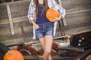Preteen Girl Portrait at the Pumpkin