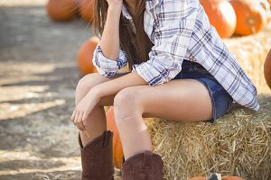 Preteen Girl Portrait at the Pumpkin