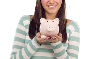 Ethnic Female Holding Piggy Bank on