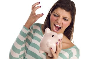 Ethnic Female Yelling At Piggy Bank