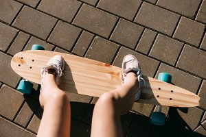 Girl with wooden longboard skateboar
