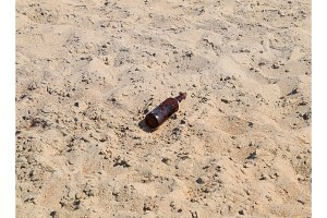 An empty bottle of beer is lying on