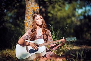 Young hippie girl with guitar