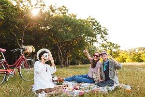 Beautiful girls sitting on picnic