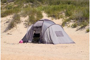 Tourist tent on the sand. Parking of