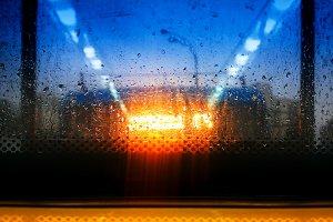 Heavy rain through bus window backgr